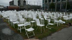The chairs represent the 182 people that got killed.